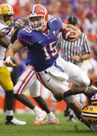 Tim Tebow runs with the ball